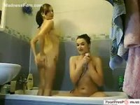 Fun young sisters modeling nude together