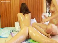Pretty teen sisters exploring baby oil and assholes