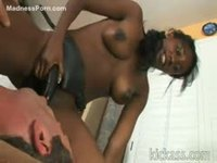 Ebony girl pegging a white dude in his ass