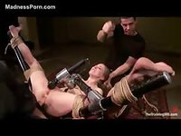 Two guys have fun with tied up woman