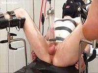 Man in machine bondage pleasured
