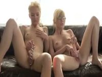 Passionate kissing and pussy play between twin sisters