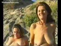 Mature sisters naked on the beach for fun