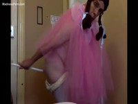 Crossdressing guy dancing in a tutu while wearing a baby diaper
