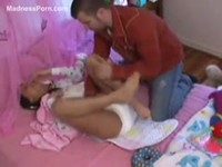 Beautiful brunette newcomer being treated as if she's a baby in the adult baby diaper video