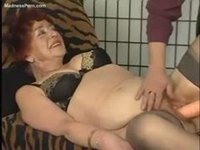 Friendly granny with a hairy pussy masturbating with a big toy