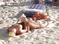 Wild times on the beach as this naughty blonde slut gives her boyfriend a public blowjob