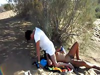 Horny dude face fucking his nude amateur wife while relaxing on the naked beach