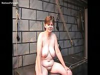 Chubby older whore with gigantic hanging breasts getting abused in the dungeon
