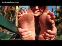 Pretty teenage girl modeling her dirty feet in this foot fetish flick