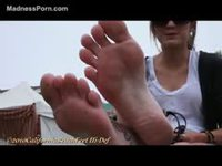 Cute nineteen-year-old fresh-faced girl modeling her feet and toes for a stranger
