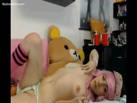 Pale skinny teenage girl with long pink hair flashing her meaty pussy on cam