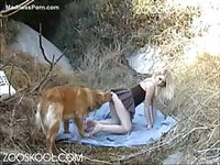 Filthy minded blonde teenage girl bends over outdoors to have sex with an animal