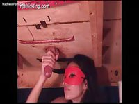 Asian young hottie in a mask jerking a trapped guy off