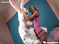 Cute blonde teen in pigtails blowing and fucking a well-endowed guy in a bunny costume