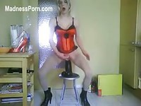 Dude in sexy red lingerie and stockings stuffing a huge toy in his ass