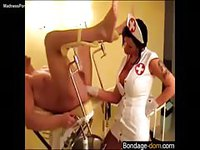 Sinful nurse giving a dude a deep anal exam with her fist