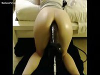 Amateur mounts her incredible ass on an enormous black dildo