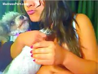 Chubby teen with large natural breasts gets horny with an animal