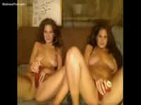 Twin sisters experimenting with a dildo during their webcam show
