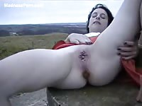 Innocent looking pale brunette coed lifts her skirt and poops outdoors