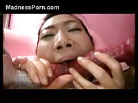 Asian street whore exposes her young body and deepthroats dog dick in this beast sex video