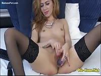 Incredible petite cougar in black nylon stockings pleasuring herself on cam