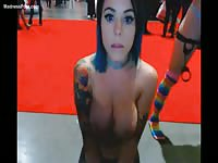 Dark-haired tattooed college girl with huge melons exposed and chatting with her viewers live