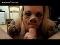 Blonde tattooed tramp humiliated as her dominating partner forces her suck dick in a pig nose