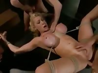 Devoted dick sucking blonde shows off her well-earned skills in this BDSM gangbang video
