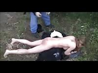 Submissive whore is forced to strip naked outdoors for a brutal ass lashing in this video