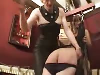 Incredible mature whore dressed in sexy black attire dominates this willing slut with spanking