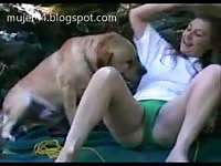 Sweet married woman in little green panties flirting with the family pet before getting fucked