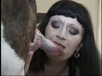 Married showing off her fantastic cock blowing skills on a large dog in this bestiality movie
