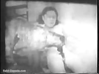 Classic bestiality hardcore movie captured by a husband years ago as his wife bangs a dog