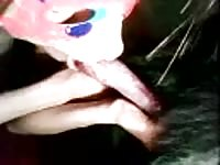 Masked amateur young whore tries or cock sucking skills out on the family pet in this video