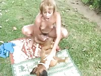 Married hussy getting her sweet fuck hole humped by an enormous dog in this beast sex video
