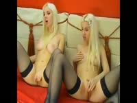Inviting just legal twin sisters stripping each other down and probe pussy during cam show